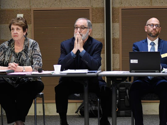 From left, Michigan Department of Education senior executive policy advisor Linda Forward, social studies consultant Jim Cameron, and social studies consultant for assessment Scott Koenig list to audience comments last year.