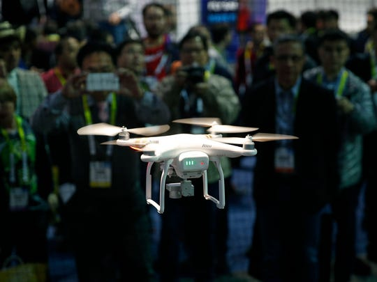 A drone hovers at a booth during CES International