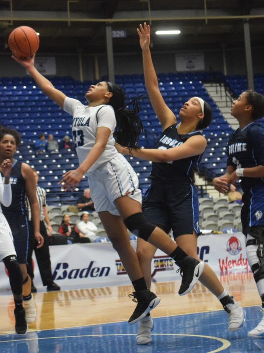 Loyola Prep's K.C. Sims (23, left) goes up for two against Ursline Academy's Kennedi Jackson (23, right) in the LHSAA Division II semifinals held Tuesday, Feb. 27, 2018 at the Rapides Parish Coliseum in Alexandria.