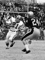 Rodger Bird, then a running back for Kentucky, heads up field to face a Vanderbilt defender during the 1963 game in Nashville.