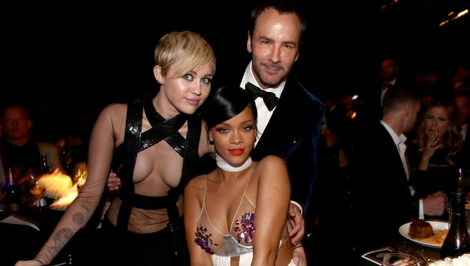 (L-R) Recording artists Miley Cyrus, Rihanna and honoree Tom Ford attend amfAR LA Inspiration Gala honoring Tom Ford at Milk Studios on October 29, 2014 in Hollywood, California.