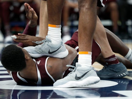 Mississippi State's Nick Weatherspoon is stepped on
