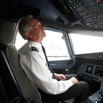 "Captain Chesley ""Sully"" Sullenberger, who landed US Airways Flight 1549 on the Hudson River, sits in the cockpit of a US Airways plane at LaGuardia Airport on Oct. 1, 2009."