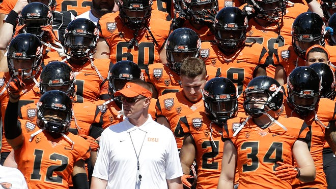 Oregon State coach Gary Anderson walks onto the field with the orange squad before their NCAA college football spring game in Corvallis, Ore. The Pac-12's only new coach this fall realized he was rejoining a league with remarkable talent and several blossoming programs that are sure to make life tough on Saturdays.