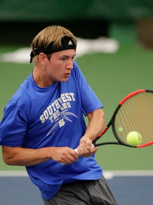 Green Bay Southwest's Johnny Zakowski hits a backhand return in a third-round singles match at the WIAA state boys individual tennis tournament last week in Madison.