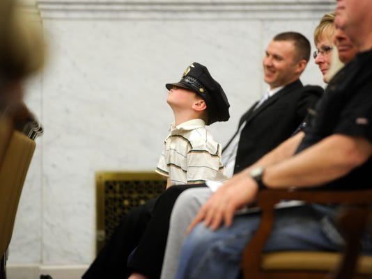 6-year-old Ty Anderson wears his father's hat as York City Police Officer Ryan Anderson receives two Chief's Commendations during the York City Police Departmental Awards Ceremony Friday, March 23, 2012.   DAILY RECORD/SUNDAY NEWS - KATE PENN