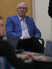 Lions team president Rod Wood listens as general manager