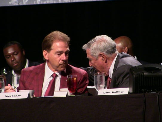 Nick Saban talks with former Alabama coach Gene Stallings