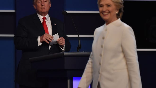 Democratic presidential nominee Hillary Clinton departs the stage following the third and final presidential debate with Republican nominee Donald Trump.
