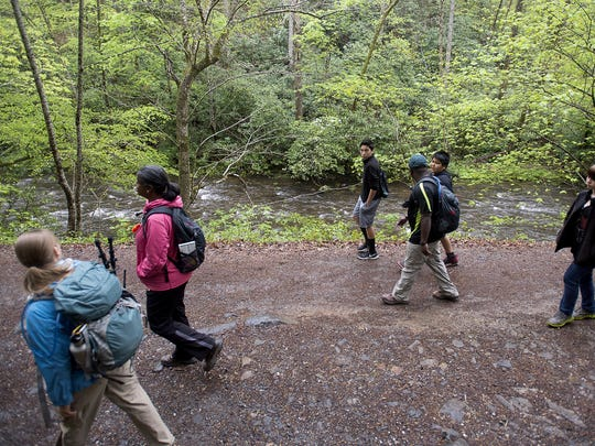 Cherokee middle school students hike along a creek April 22, 2016 through the Deep Creek section of the Great Smokey Mountain National Park outside Bryson City.