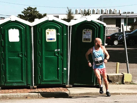 After making a not-so-fast bathroom break, Scott Wietecha had to pick up his pace in order to win his sixth consecutive St. Jude Rock 'n' Roll Nashville Marathon.