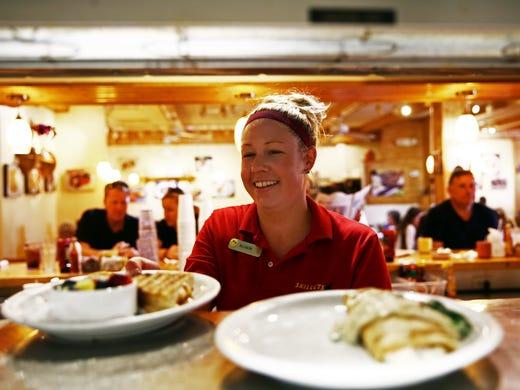 Waitress Allison Myers Of Bonita Springs Grabs Plates