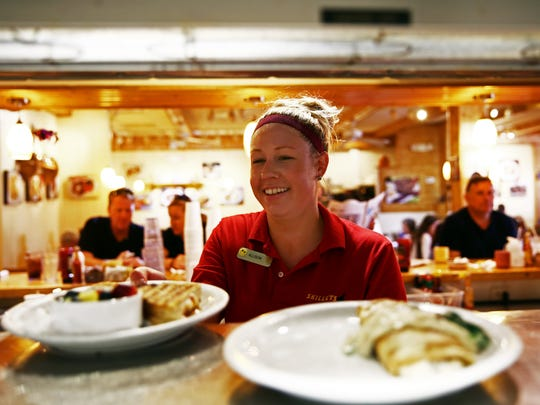 Waitress Allison Myers of Bonita Springs grabs plates to deliver at Skillets in Naples on Thursday, Oct. 15, 2015.