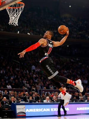 West Team's Russell Westbrook, of the Oklahoma City Thunder, dunks during the first half of the NBA All-Star game on Feb. 15, 2015, in New York.