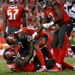 Tampa Bay Buccaneers free safety Bradley McDougald (30) is congratulated by cornerback Vernon Hargreaves (28) after he intercepted the ball during the second half against the Seattle Seahawks at Raymond James Stadium. Tampa Bay Buccaneers defeated the Seattle Seahawks 14-5.