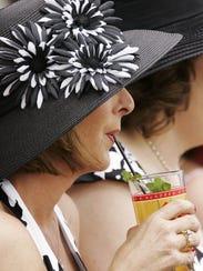 Laura Martindale of Jackson, Tenn., sips on aMintJulepat