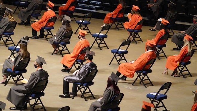 University High School grads sit apart to keep social distant at commencement exercises over the weekend. What measures will schools come up with when classes start again in the new school year?
