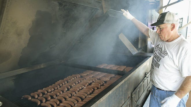 Tom Abney smokes sausages for Southside Market and Barbeque of Elgin and Bastrop in 2017. Southside was one of 62 businesses that received loans through the federal Paycheck Protection Program.