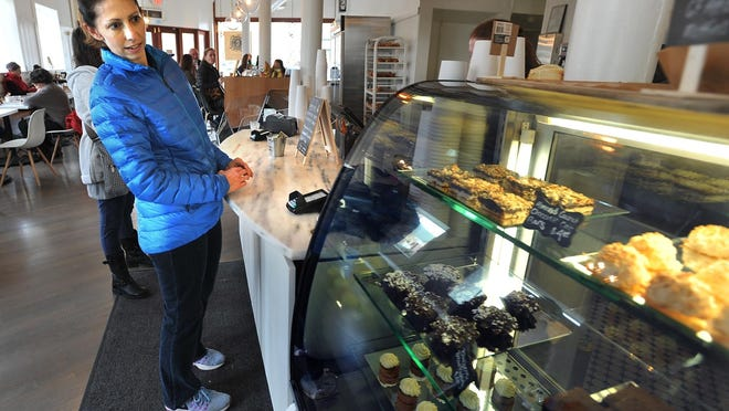 Ann Dekruyff looks over pastries for sale at the Common Cafe & Kitchen in Natick in 2017.