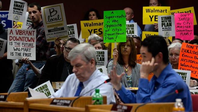 Green Bay City Council member Brian Danzinger asks questions to a Walmart representative during the Green Bay City Council meeting Tuesday at City Hall.