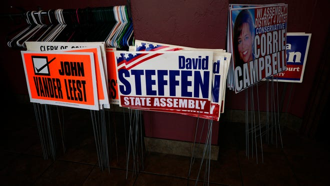 Political signage during the Brown County Republican Party at the Ravine Pub and Grill in Bellevue.