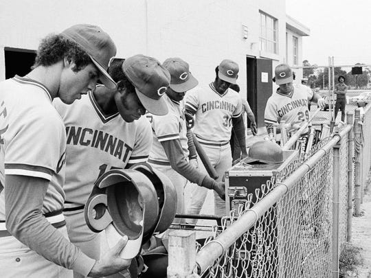 Cincinnati Reds players looking for their helmets and bats at Tampa, Florida, on Wednesday, April 3, 1980 as they continued to work out even while they were on strike.