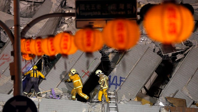 Rescuers continue their search for survivors from a collapsed building following the 6.4 magnitude earthquake, in Tainan City, southern Taiwan, on the eve of the Chinese Lunar New Year, Feb. 7,  2016.