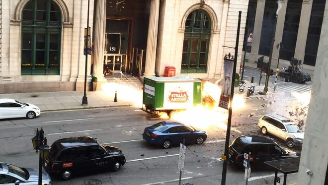 """A beer truck explodes during filming of """"Transformers: The Last Knight"""" in downtown Detroit on Saturday, July, 23, 2016."""