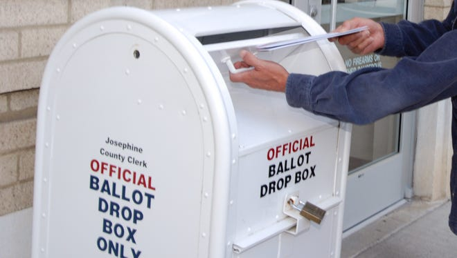 A voter casts his Josephine County ballot.