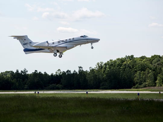 A corporate jet departs for New York Wednesday, June