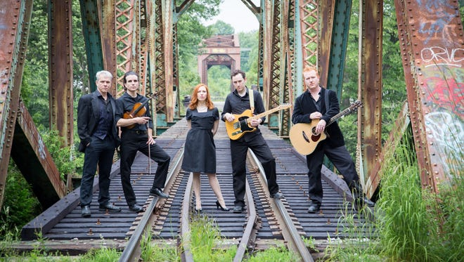 "Left to right, Larry Tobias, Andrew Ross Crowe, Amanda Ryan Paige, Mike Rosengarten and Chris Blisset in ""Ring of Fire: The Music of Johnny Cash."""