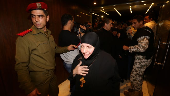 Kidnapped nuns arrive at Jdeidet Yabus on the Syrian side of the border with Lebanon on March 10, 2014, after they were exchanged for women in government prisons.