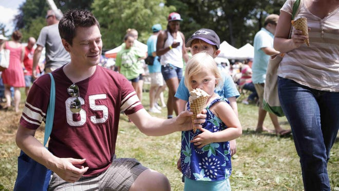 Pat McCay and Madelyn share a gelato from Caffe Gelato at last year's Ice Cream Festival at Rockwood Park.