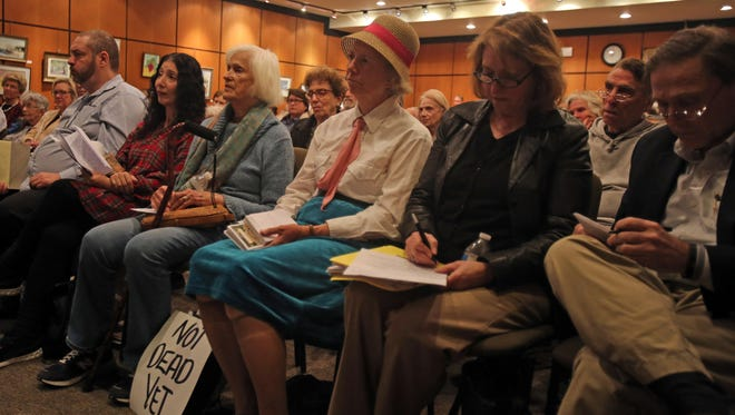 """People packed Scarsdale Public Library to hear the debate on whether New York State should have """"aid in dying"""" legislation on April 25, 2016."""