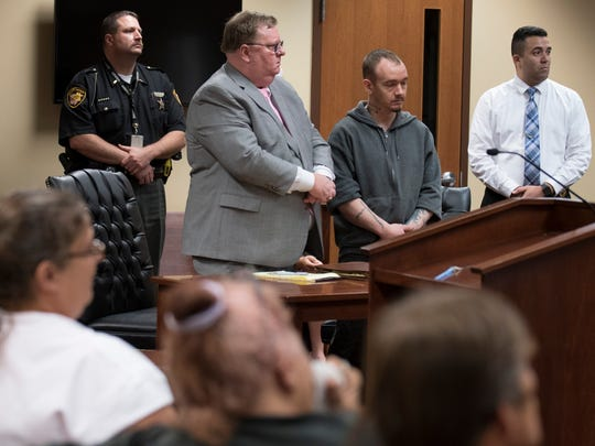 Christopher Detty, second from right, addresses Jason Bartley's family and conveys how sorry he is in the role he played that lead to Jason Bartley's death in October of last year.