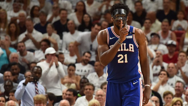 Philadelphia 76ers center Joel Embiid (21) gestures in the game against the Miami Heat during the first half in game three of the first round of the 2018 NBA Playoffs at American Airlines Arena.