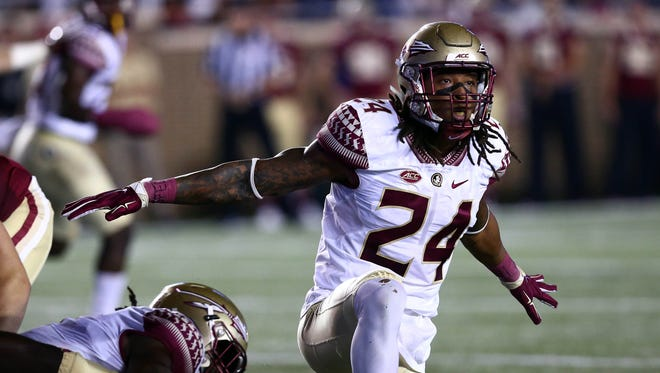 Florida State Seminoles linebacker Terrance Smith (24) reacts against the Boston College Eagles during the first half at Alumni Stadium.