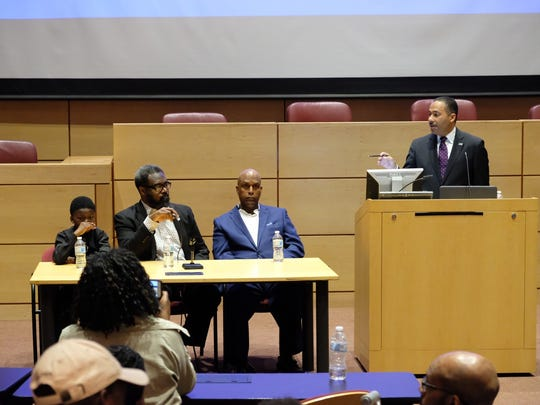 Detroit City Councilman James Tate, middle, answers a question about pitching black-related stories in newsrooms from Andrew Humphrey, right.