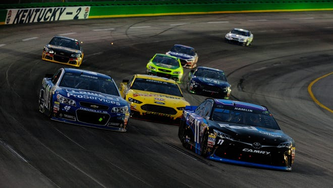 Jeff Curry/Getty Images Denny Hamlin, driver of the No. 11 FedEx Office Toyota, leads a pack of cars around the turn during last year?s Quaker State 400 at Kentucky Speedway. SPARTA, KY - JULY 11:  Denny Hamlin, driver of the #11 FedEx Office Toyota, leads a pack of cars during the NASCAR Sprint Cup Series Quaker State 400 presented by Advance Auto Parts at Kentucky Speedway on July 11, 2015 in Sparta, Kentucky.  (Photo by Jeff Curry/Getty Images)