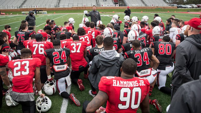 Ball State head coach Mike Neu talks to the team after the annual spring game April 14 at Scheumann Stadium.