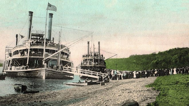 Colored photo of the steamboat landing at New Richmond, Ohio. New Richmond was a steamboat terminus, where passengers and freight were loaded. Several steamboats were built in New Richmond.