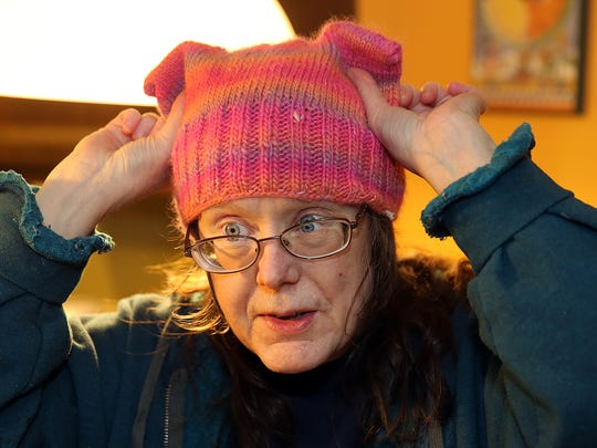 Dale Walker of Bainbridge Island shows a finished hat. The hats are part of the anti-Trump Pussyhat project.