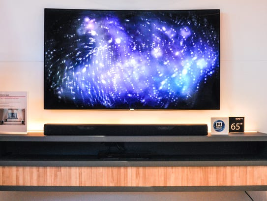 For scale, the Samsung soundbar is positioned beneath