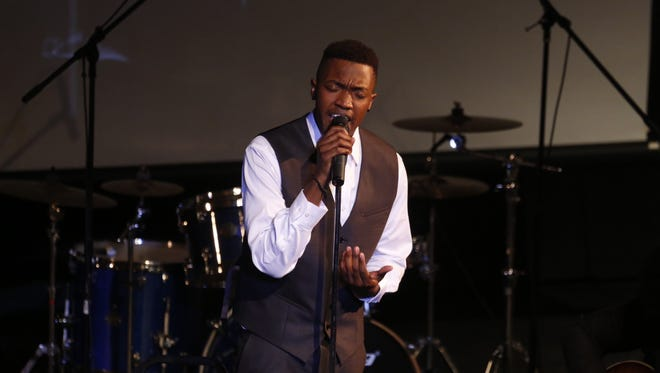 Jamel McNair sings at his father's funeral Thursday, June 12.