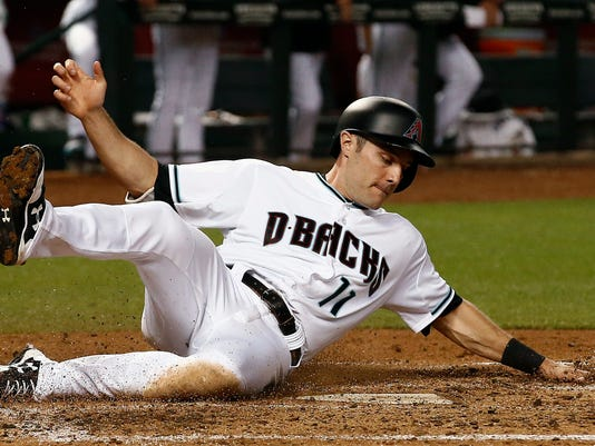 Arizona Diamondbacks' A.J. Pollock slides into home plate to score a run against the Pittsburgh Pirates during the fourth inning of a baseball game Friday, May 12, 2017, in Phoenix. (AP Photo/Ross D. Franklin)