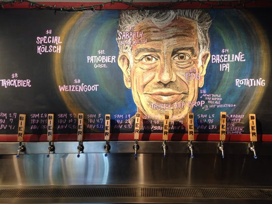 Bier Brewery's taproom and marketing manager Sarah Buschmann created a tribute to Anthony Bourdain. She creates the chalk art to display the latest beer lineup in the Indianapolis taproom.