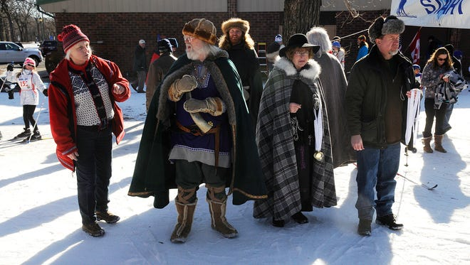 Sons of Norway members in traditional dress wait at the finish line during the 2015 Barnelopet at Riverside Park in St. Cloud.