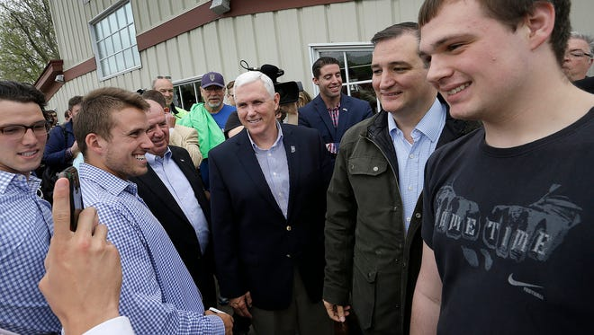 Indiana Gov. Mike Pence (center) joined Sen. Ted Cruz during a primary campaign stop Monday, May 2, 2016, in Marion.