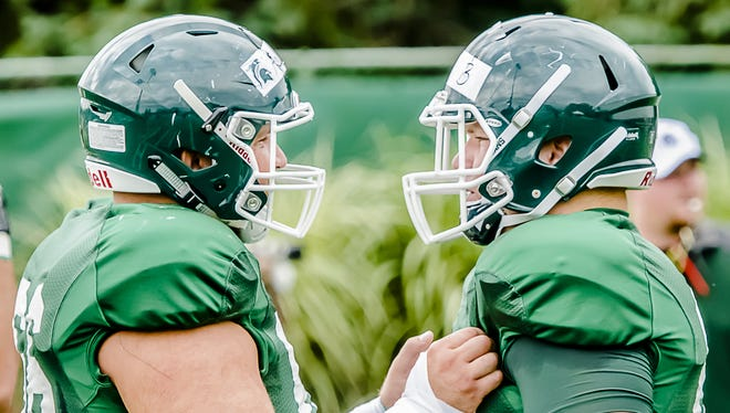 MSU offensive lineman Jack Allen prepares for a blocking drill with his brother MSU offensive lineman Brian Allen during a summer camp practice Wednesday August 6, 2014 at the Duffy Daugherty Building in East Lansing.