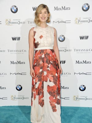Rosamund Pike arrives at the 8th Annual Women In Film Pre-Oscar Cocktail Party on Friday, Feb. 20, 2015, in Los Angeles.